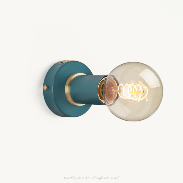 A simple yet discerning light that forms part of our latest colour rich range with subtle brass detailing. Initially designed as a minimal wall sconce, it also looks stylish mounted to the ceiling. It is available in 5 pastel colourways as well as classic metal finishes such as brass and gunmetal grey.