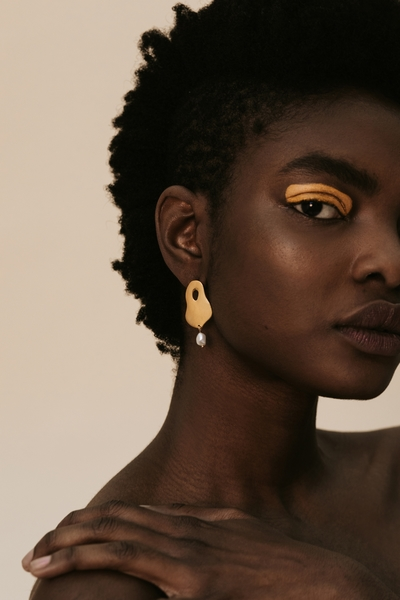 Part of the Hollow Beauty Collection  Material:  - 2cmlong 18ct gold brass earring  - with freshwater pearl    All our jewelry is handmade at our studio in Woodstock, Cape Town. Our jewellery is nickel free andsafe for sensitive ears.
