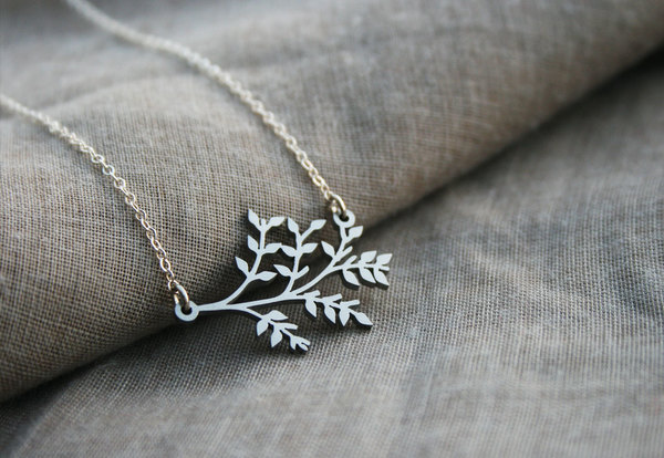 Sterling silver chain with stainless steel pendant.