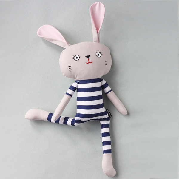 Pyjama Bunnies are friendly companions from playtime to sleep time! They are available in arange of limited edition fabrics andwill steal your heart with their kooky smile. Pyjama Bunnies are safe for little ones as they have no loose parts. That makes them theperfect gift for an expectant mama or the little hooligans in your life.  This listing isfor a bunny with bold navy blue striped pyjamas.All materials are 100% cotton. Screen printed and partially embroidered face; no loose parts.  Dimensions*: The dimensions are roughly as follows: h – 41cm; w – 13cm * May vary slightly as item is handmade