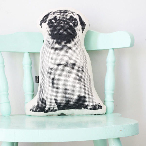 Scout the Pug is part of a menagerie of animal cushions for your home.  Scout is screen printed by hand in black water-based ink on thick 100% cotton off-white seeded fabric. He is backed in soft stone coloured cotton twill and has a woven label sewn into the side. He is plushly stuffed with unicurlfor great recovery and maximum cuddles. Scout is printed in a course bitmap pattern,whichup close seems quite modern and abstract, but take one step back and hispersonality comes shining through. Hewill make the perfect pet for your couch!  Dimensions* : h – 45cm; w – 31cm (at widest point); d –15cm * May varyas item is handmade