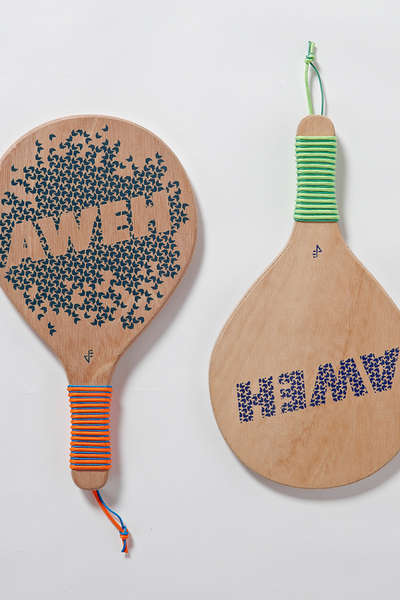 A unique and creative take on beach bats, where a collection of 3 local South African words are made into 6 different prints and screen printedonto a hard wood marineply.Choosebetween a lighter or heavier bat depending on your playing style. Then pair your personal setof bats from the various selection of artworks.  Ball supplied with a set of bats.  Please email your desired combination after placing an order.  Please Note: All prices are for South Africa. For international orders please enquire, by clicking here.  Material:Hard wood marineply/birch ply, rope  Dimensions:W 210 mm x L 365 mm  PDF Download:Beach Bats