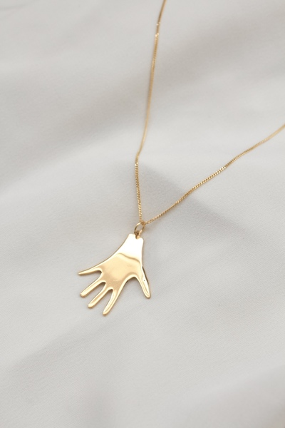 This necklace features a brass Baby Hand pendant on a gold plated chain.  - Material: 18k gold plated brass Baby Hand pendant on gold plated sterling silver chain  - Approx. 2cm long  - Necklace hassterling silver chain option  - Chain length: 45cm  All our jewellery is handmade in our Woodstock studio.