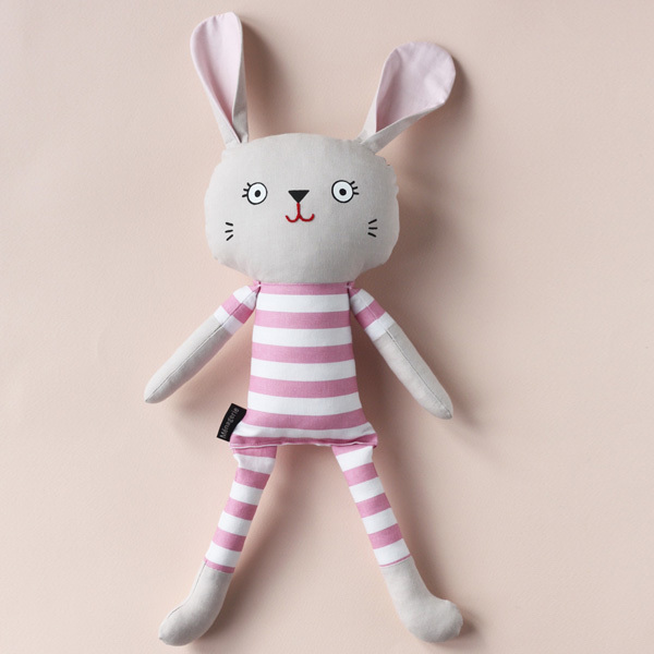 Pyjama Bunnies are friendly companions from playtime to sleeptime! They are available in a wide range of limited edition fabrics andwill steal your heart with their kooky smile. Pyjama Bunnies are safe for little ones as they have no loose parts. That makes them theperfect gift for an expectant mama or the little hooligans in your life.  This listing isfor a bunny with pinkbold striped pyjamas.All materials are 100% cotton. Screen printed and partially embroidered face; no loose parts.  Dimensions*: The dimensions are roughly as follows: h – 41cm; w – 13cm * May vary slightly as item is handmade