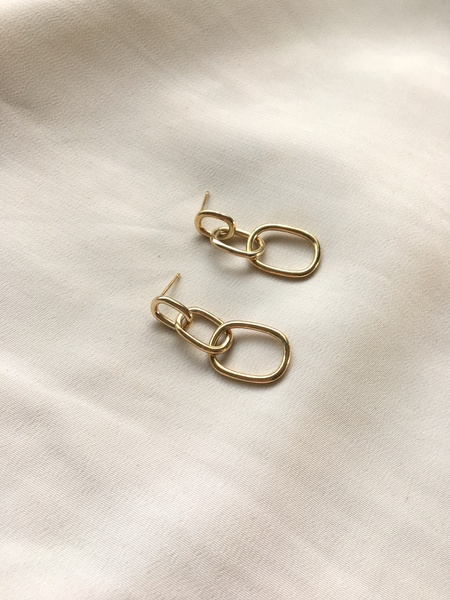 Long flowing statement chain earrings that sways along as you do. Perfect for a dressy, special occasion or fun to dress down with a simple white t-shirt and jeans. Gold plated sterling silver earrings.