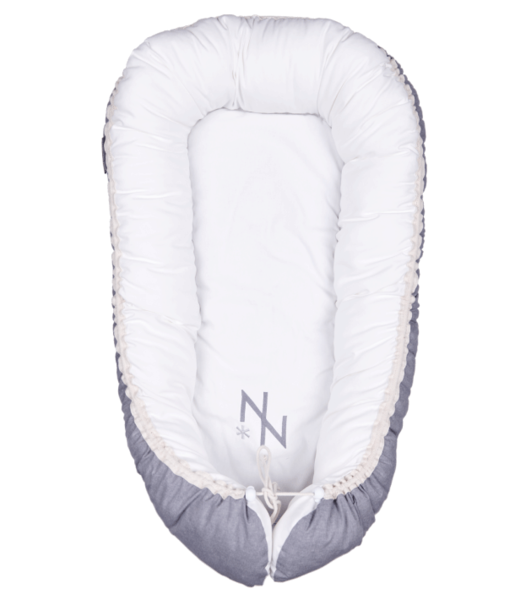 The lightweight, easy-to-carry cocoon is lined with 100% cotton and not only keeps your baby safe and snug, but also offers a great solution for traveling, co-sleeping and nappy changing via an adjustable bottom flap, whether you're at home or on the go. It also fits perfectly in your baby´s cot for snug and comfortable sleeping.  Suitable from 0-12 months Dimensions sleep area: 75cm x 30cm Outer lining: 100% Cotton Inner filling: Breathable Polyester Fiber  Wash the whole nest in the machine on a 40 degree program, dry flat or hang  Shipping: Once your payment notification is received, your order will be processed. Within Cape Town and major centers 1-3 days and 2-4 days to the rest of South Africa.