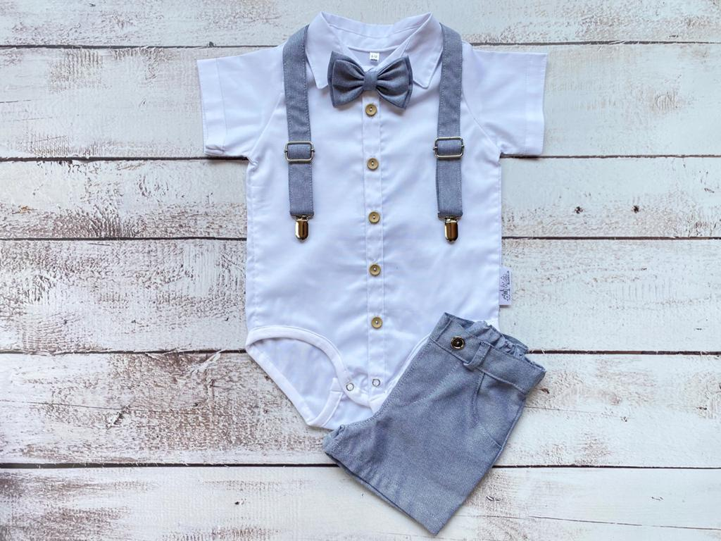 Grey shorts, suspenders bowtie and white button up shirt.