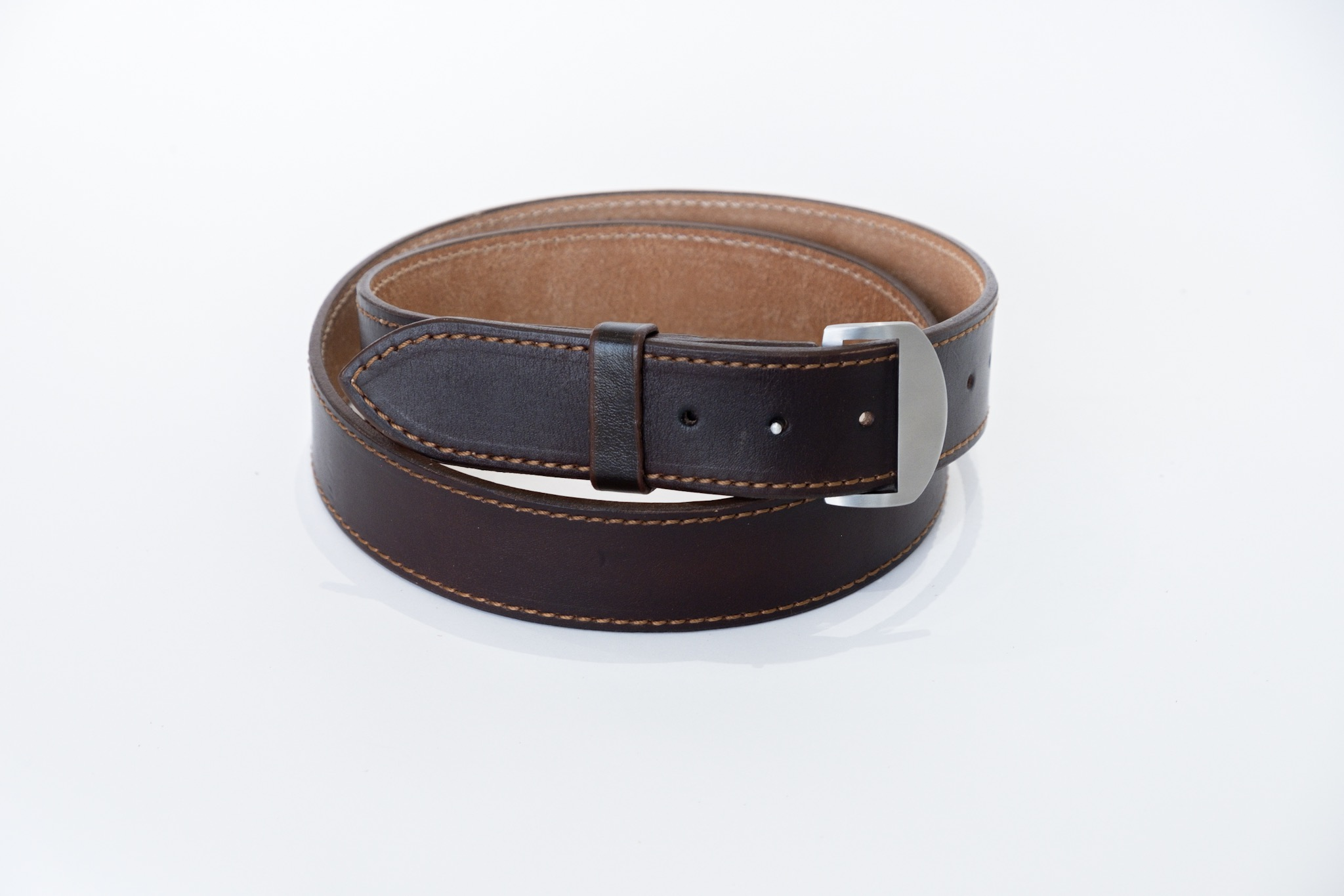This is a special knife-buckle belt - the buckle doubles up as a knife for self-defence.