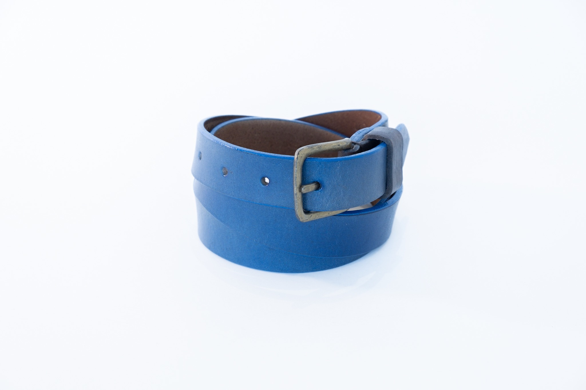 This beautiful and stylish accessory is made with a natural veg tanned genuineleather, and isa unique one of a kind. No shortcuts are taken.  This belt is both functional yet creates a striking look to your outfit. This is the kind of belt that you can hand down to your children. It's made to last!  NOTE: All belts can be made up stitched or plain.Please also note that all belts come in two different widths.  How to measure the correct length of your belt.