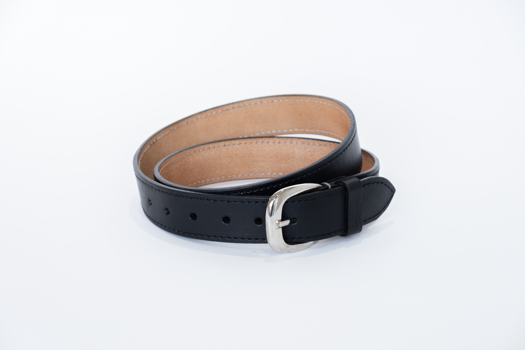 This beautiful and stylish accessory has so much character in the natural veg tanned genuine leather. Each belt is finished off with a hand stitched detail that makes this accessory a unique one of a kind. No shortcuts are taken.  This versatile belt can be worn with anything! You can dress it up for a smarter look, or wear it casually for the everyday, with jeans, or to the office - a must have for your wardrobe. This is the kind of belt that you can hand down to your children. It's made to last!  NOTE: All belts can be made up stitched or plain. Please note that all belts come in two widths.  How to measure the correct length of your belt.
