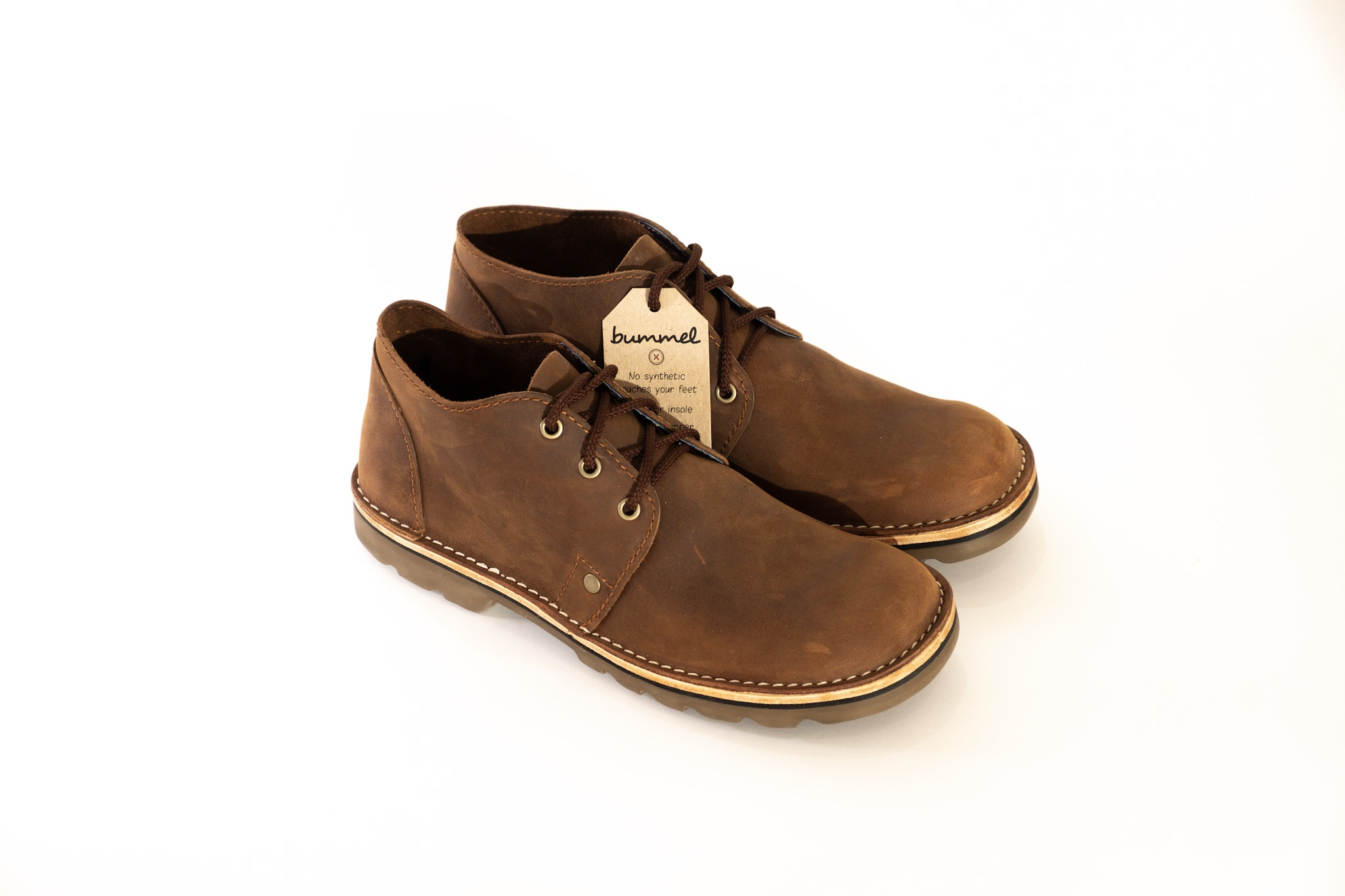 This Savanna Veldskoen is as iconic as the Savanna plains of Africa. It is Bummel's lace up boot - a classic, rugged, handmade Veldskoen. The wide square toe shape is perfect for a person with a wider foot. Only the best full grain leathers are used combined with a veg tanned leather insole and soft leather lining all made in SA. These Savannas come with a rubber sole that is long lasting, not too hard and does not crack. Let your feet feel the luxury of an all leather shoe that is comfortable for years to come. Happy Strollin'!  If stock not available, the Savanna can be made for you on order which will take 3 weeks from the date of payment.  IMPORTANT: Before ordering, please consult the size chart and add your actual foot measurement to the comments section when ordering. Click to view size chart and foot measurements.  For extra comfort and care add aBummel leather footbed and leather foodto your cart.  Find out more interesting facts about Bummel Shoes - read more...  FREE SA shipping of orders over R1000.