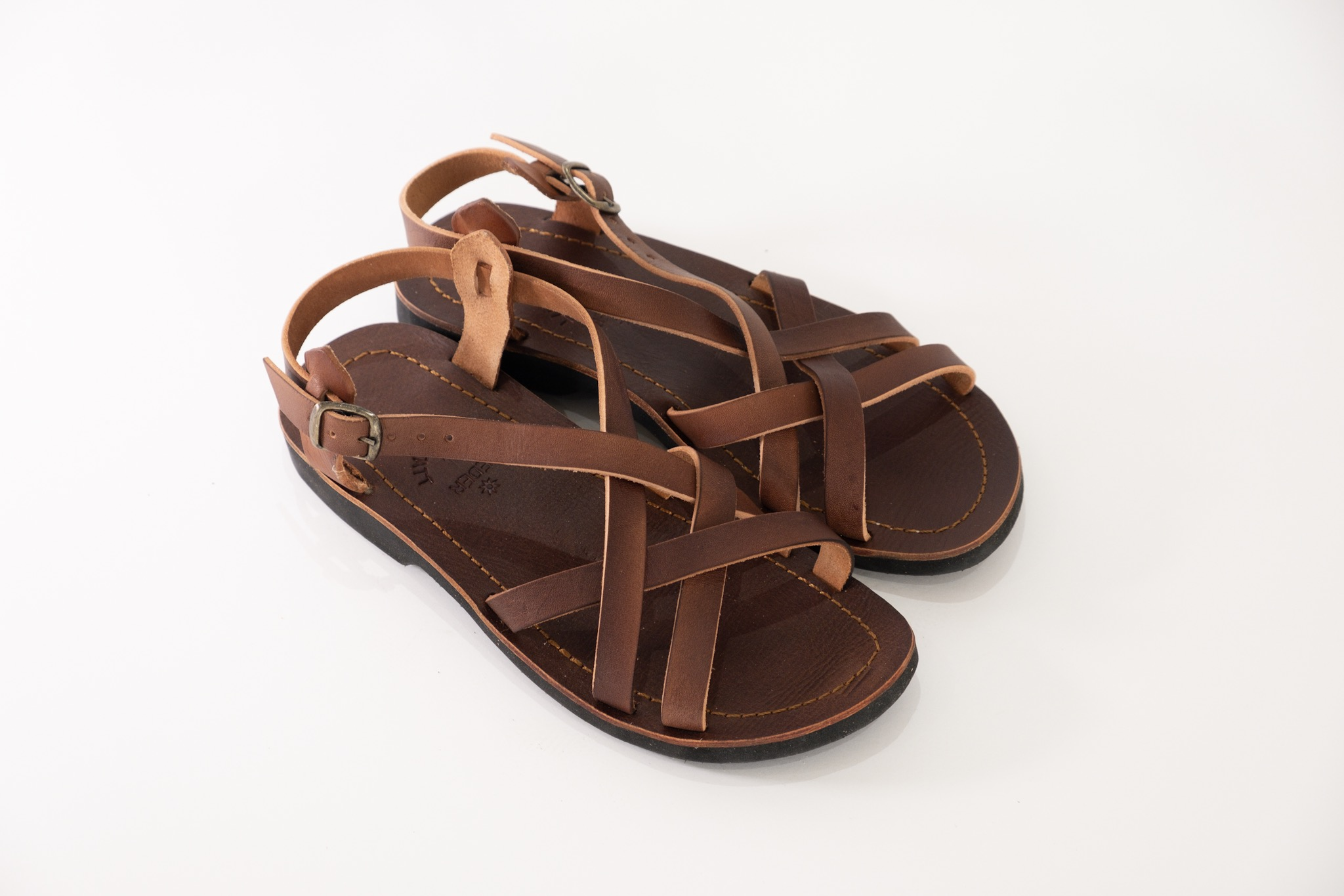 This classic woven strap sandal is unique, comfortable and durable. Whether you're walking all day, working all day, shopping all day, enjoying a morning or evening stroll, these are the shoes to add to your collection. Stylish in its simplicity allows this sandal to go with almost any outfit. The back strap keeps the foot secure, and the buckle can be used to adjust the size to suit the comfort of your feet.These sandals have veg tanned leather straps, a veg tanned leather insole, and a light weight EVA sole for comfort and cushioning.  There are two versions of this sandal – one where the straps go over the foot, theNala; and the other where an extra strap holds the big toe, theNala TS.  Happy strolling!  IMPORTANT: Before ordering, please consult the size chart and add your actual foot measurement to the comments section when ordering.Click to view size chart and foot measurements.  Find out more interesting facts about Bummel Shoes -read more...  FREE SA shipping of orders over R1000.