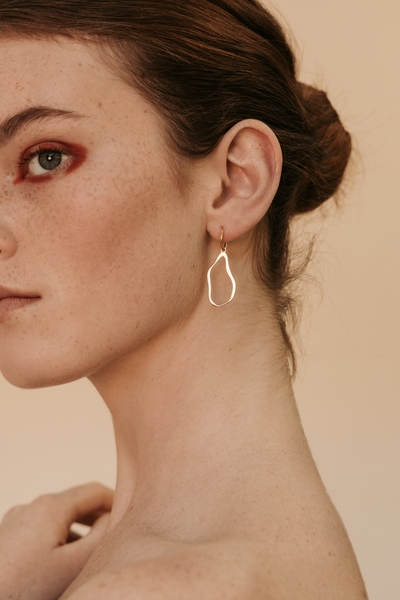 Part of the Hollow Beauty Collection  Material:  - 18ct gold vermeil sleeper earrings (12mm diameter)  - 2cmlong 18ct gold brass pendant  All our jewelry is handmade at our studio in Woodstock, Cape Town. Our jewellery is nickel free andsafe for sensitive ears.