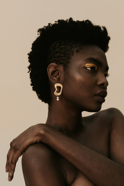 Part of the Hollow Beauty Collection  Material:  - 2,5cmlong 18ct gold brass earring  - with freshwater pearl  All our jewelry is handmade at our studio in Woodstock, Cape Town. Our jewellery is nickel free andsafe for sensitive ears.