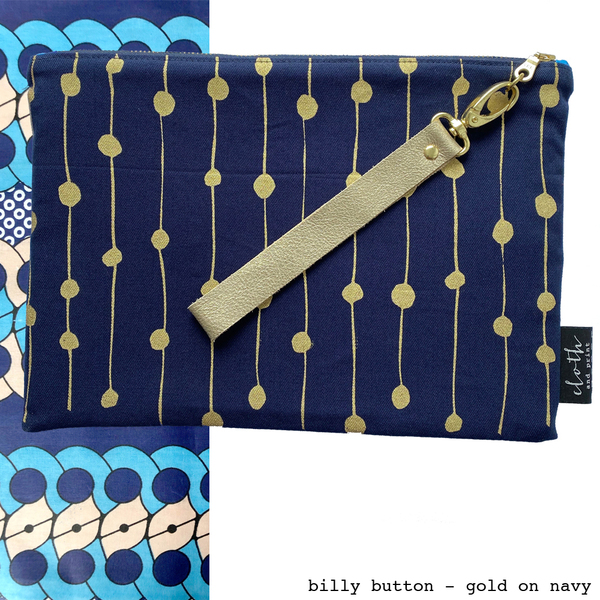 The CAPULANA CLUTCH is a tribal style statement. Luxurious and durable, the clutch purse is the perfect day to night accessory and even holds your iPad.  This CAPULANA CLUTCH is hand screen-printed with original designs onto 100% cotton and linen/cotton using textile inks. The clutch is padded and fully lined with a bright, traditional Capulana cloth sourced from Mozambique and Swaziland.  Available in one size and designed to fit an iPad.   sturdy YKK zip, handmade leather wrist strap, attached with a high quality brass snap hook genuine leather strap woven brand label bag is padded to protect your device fully lined with a cotton Capulana cloth lining   We can also MAKE TO ORDER this product if you'd prefer another print/fabric combination. Send an email request to hello@clothandprint.com  Please view the collections available. This is a hand printed product and variations of print placement are all part of the charm.  APPROX. DIMENSIONS:   L 28 x W 20 cm   FABRIC INFORMATION:   100% medium weight cotton or 50% linen / 50% cotton blend   WASH CARE:  hand wash only | do not rub print | warm iron | do not tumble dry  handmade in Cape Town, South Africa