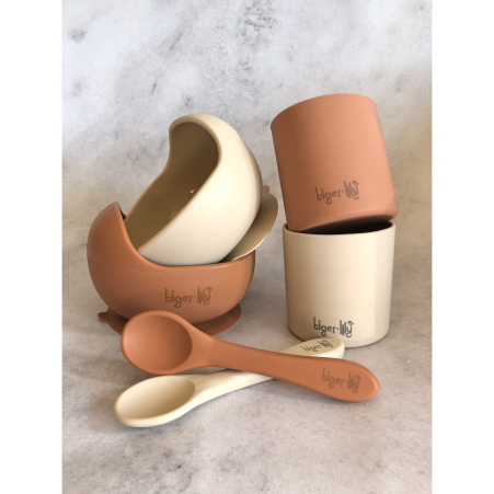The Tiger Lily Silicone Bowl Sets come in 5 beautiful, trendy colours. Each set consists of a suction bowl with a curved rim to encourage self feeding, a silicone spoon (that works wonders as a teether too!) and a cup. Not only are these items made from food-grade silicone (BPA free) and super soft, making it easy and safe to use by little ones, but they are anti-bacterial, eco-friendly and dishwasher safe. These sets match with our range of Silicone Bucket Bibs making them the perfect combination of 'tools' when embarking on the journey of solids.