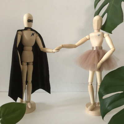 The range of Tiger LilyMannequins includes our Superhero and Ballerina and they make an amazing decor accessory. Movable arms, legs, neck and waist make it possible to create a variety of poses. Let your mannequin be an expression of your creativity! The Superhero Mannequin comes with a removable black cape and has a black mask painted on his faceand lightening bolt painted on his chest. The Ballerina Mannequin comes with a removable ballet skirt and has a little heart painted on her chest. The Rockstar Mannequin comes with a removable felt guitar and headband and can be customised with a name on the back of his pants (please indicate name in comments).  Wash Care: Fabric components can be rinsed, the wood mannequin can be wiped down with a damp cloth  Approx. Dimensions: The mannequin is a standard 12inch or 30cm model  Disclaimer: Our mannequins are hand decorated (with love!) and as a result there may be variances in the customisation