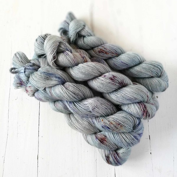 Rustic Silver Slate is a beautifully delicate pale blue with contrasting speckles (it will create a delicate tweeded knitted fabric).