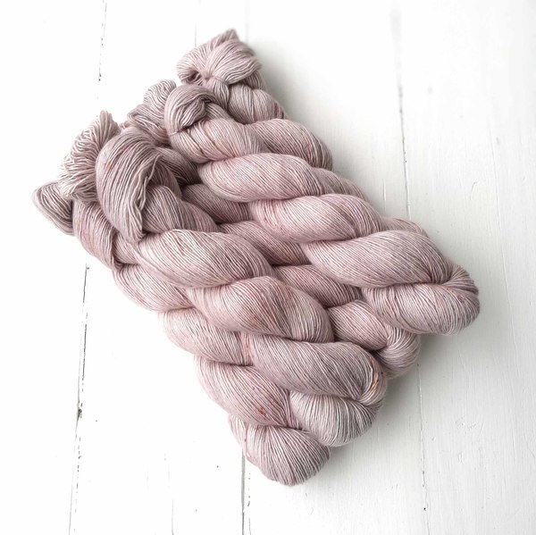 A delicate, neutral colurway with a hint of linen and a hint of blush. Darker speckles provide contrast.