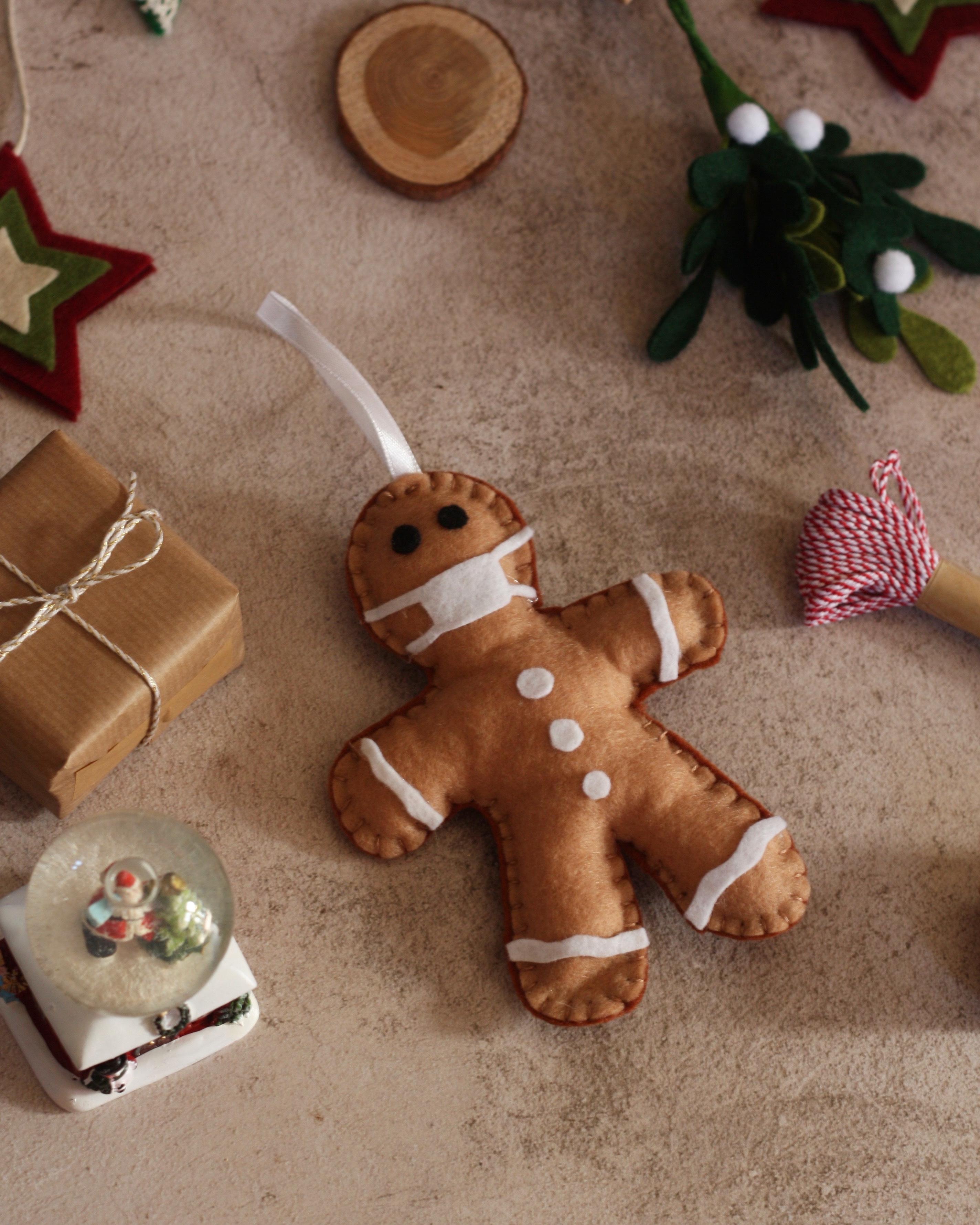 This cute handcrafted ornament just adds a bit of fun to your tree after the year 2020! Hand cut, stitched and made with love this gingerbread man has a little mask too as it's become part of our daily lives.